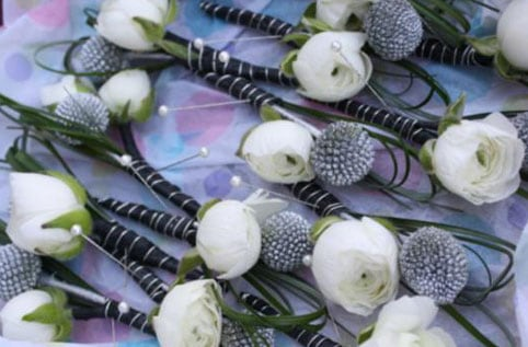 Silver sprayed billy balls and white rananculus boutonierres