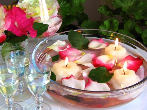 Float petals in submerged centerpieces.