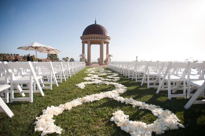 Decorative landscape design down the isle at the wedding ceremony