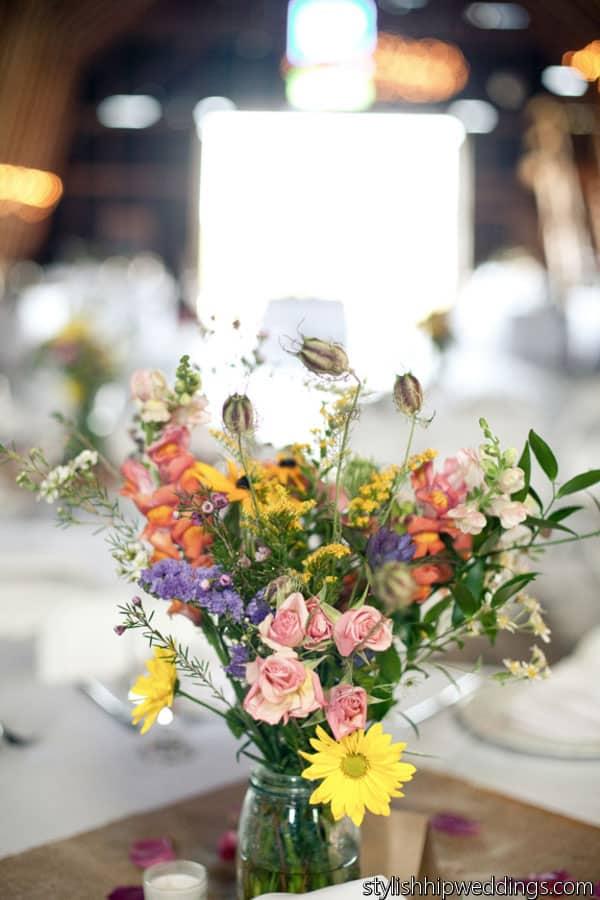 Daisies, snapdragon, and pod wildflower centerpiece