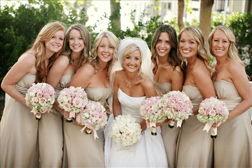 Beige Bridesmaids Dresses And Pink Bouquets