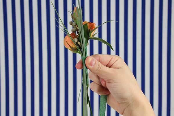 diy spray rose boutonniere tutorial- tape bear grass