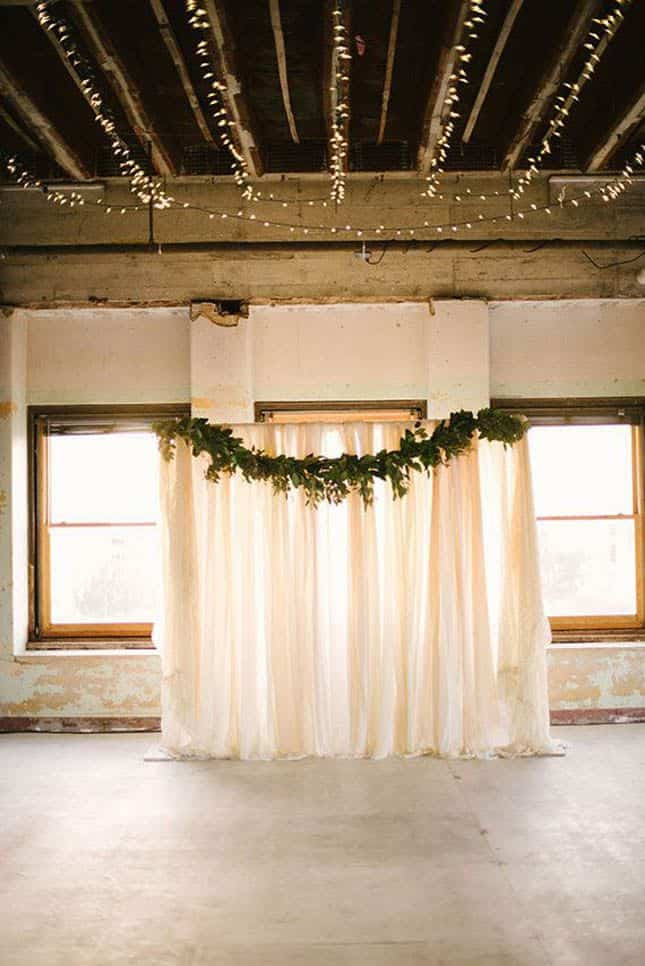 Simplify your floral arch by using inexpensive greens and sheer fabric!