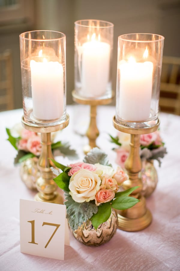 Maximize your DIY budget by accenting floral arrangements with candles!
