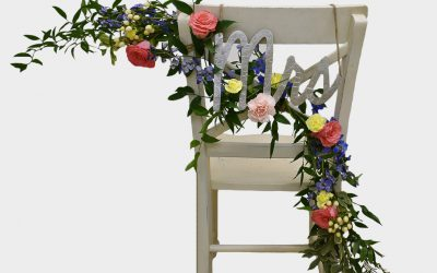 DIY Floral Chair Garland Featured on Emmaline Bride